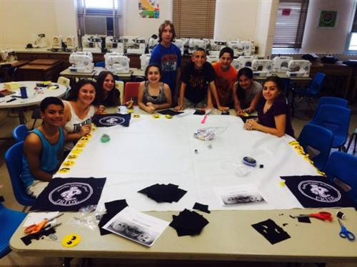 FACS students sewing a banner