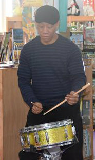 Mr. Pinkney demos how to do a paradiddle
