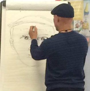 He's sketching himself!
